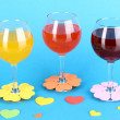 Stock Photo: Colorful cocktails with bright decor for glasses on blue background