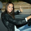 Beautiful young woman in car - Stock Photo