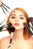 Portrait of beautiful woman with make-up brushes — Stock fotografie