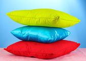 Pillows on blue background — Stock Photo
