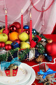 Serving Christmas table on white and red fabric background — Stock Photo