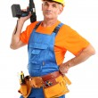 Male builder with drill in hand isolated on white close-up - Stock Photo