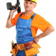 Male builder with drill in hand isolated on white close-up - Foto Stock