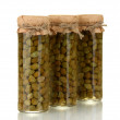Glass jar with tinned capers isolated on white - Zdjęcie stockowe