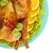 Whole roasted chicken with lettuce, grapes, oranges and spices on blue plat — Stock Photo #14081376