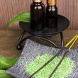 Aromatherapy setting on brown bamboo background — Stock Photo #14082266