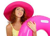 Ler vacker flicka med stranden hatt och gummi ring isolerad på vit — Stockfoto