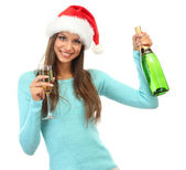 Beautiful young woman with bottle and glass of champagne, isolated on white — Stock Photo