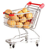 Ripe potatoes in trolley isolated on white — Stock Photo