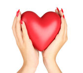 Red heart in woman's hands isolated on white — Zdjęcie stockowe