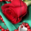 Beautiful red rose with heart pendant — Stock Photo