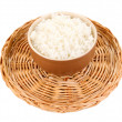 Bowl of rice on wicker mat isoalted on white — Stock Photo
