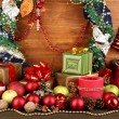 Composition from Christmas decorations on wooden table on wooden background — Stock Photo