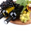 Bottles and glasses of wine and assortment of grapes, isolated on white — Stock Photo #14166092