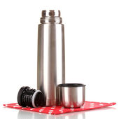 Metal thermos on napkin isolated on white — Stock Photo
