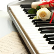 Background of piano keyboard with flower - Stock Photo