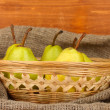 Ripe pears in sack on wooden background close-up — Stock Photo #14302307