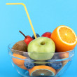 Royalty-Free Stock Photo: Glass bowl with fruit for diet on blue background