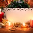 Beautiful Christmas composition on wooden background — Stock Photo #14304623