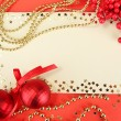 Stock Photo: Beautiful bright Christmas balls and empty postcard on red background