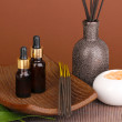 Aromatherapy setting on brown background — Stock Photo #14304725