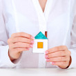 Concept: woman hands with paper house, close up — Stock Photo #14305975