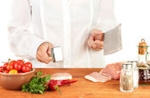 Chef cuts the meat on wooden table — Stock Photo