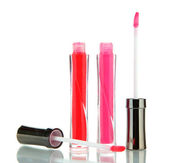 Beautiful lip glosses, isolated on white — Stock Photo