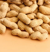 Tasty peanuts, on beige background — Stock Photo