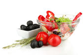 Fresh greek salad in glass bowl isolated on white — Stock Photo