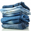 Lot of different blue jeans isolated on white — Stock Photo #14314713