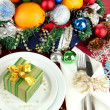 Small Christmas gift on plate on serving Christmas table background close-up - Foto de Stock