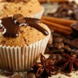 Royalty-Free Stock Photo: Tasty muffin cakes with chocolate, spices and coffee seeds, close up