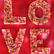Royalty-Free Stock Photo: Word Love on red background