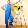 Handyman in house near the wall — Stock Photo #14317893