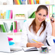 Young pretty business woman with notebook in office — Stock Photo #14318153