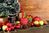 Composition from Christmas decorations on wooden table on wooden background — Zdjęcie stockowe