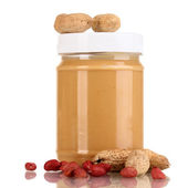 Delicious peanut butter in jar of peanut near isolated on white — Stock Photo