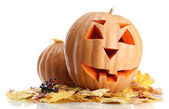 Halloween pumpkins and autumn leaves, isolated on white — Stock Photo