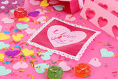 Beautiful composition of paper valentines and decorations on pink background close-up — Stock Photo