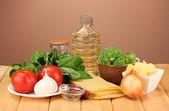 Vegetarian lasagna ingredients on brown background — Stock Photo