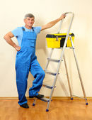 Handyman in house near the wall — Foto Stock
