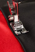 Closeup of sewing machine working part with color cloth — Stock Photo