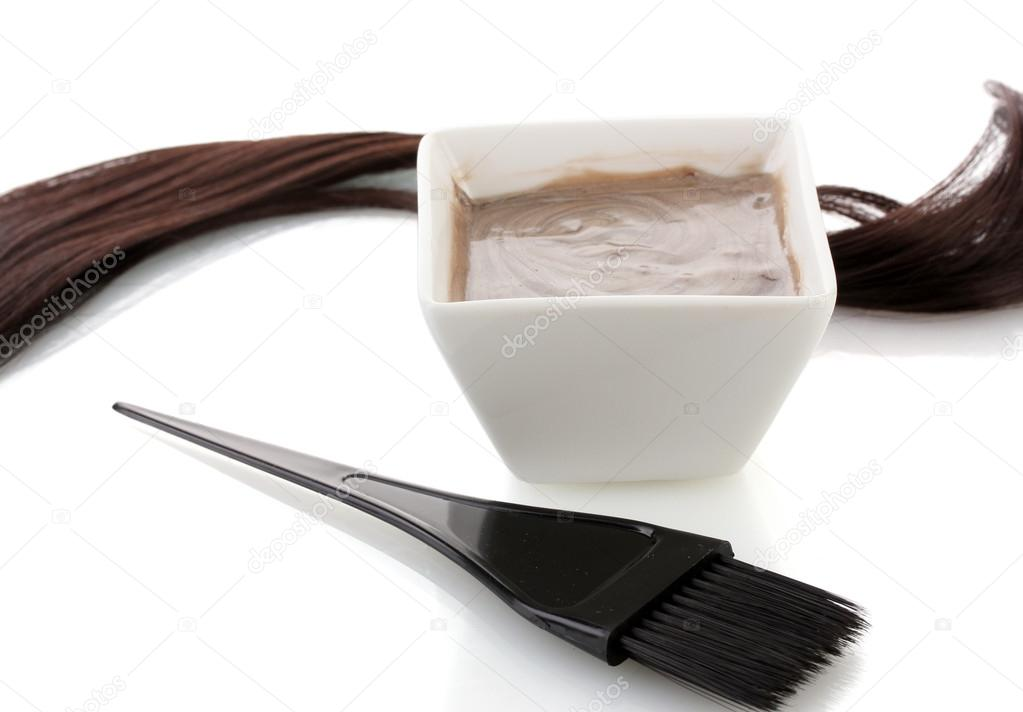 Bowl with hair dye and black brush on white background close-up — Stock Photo #14315869