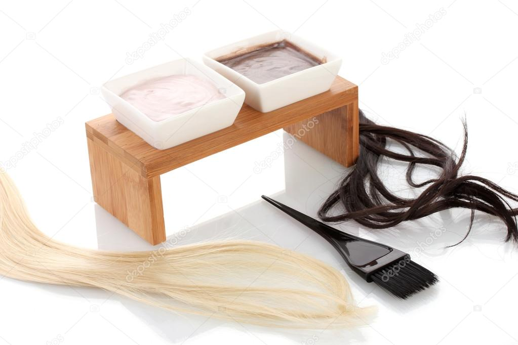 Hair dye in bowls and brush for hair coloring, on white background close-up  Stock Photo #14315873