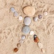 Stock Photo: Man-stones on sand