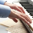 Hands of man playing piano — Stock Photo #14333111