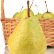 Fresh pears in wicker basket on white background close-up — Stock Photo #14333235