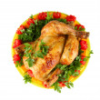 Baked whole chicken with vegetables on a green plate isolated on white - Stock Photo
