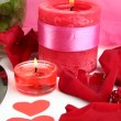Decorated candles on celebratory table close-up — Stock Photo